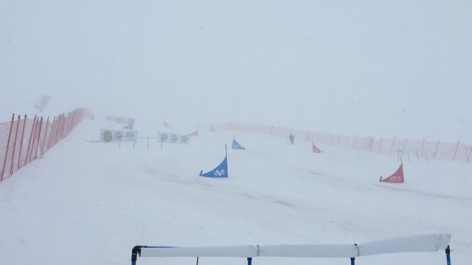 Snowstorm whirls world champs programme around